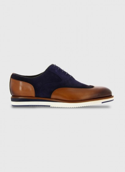 Bi-material brogue shoe with rubber sole by Emmanuelle Khanh