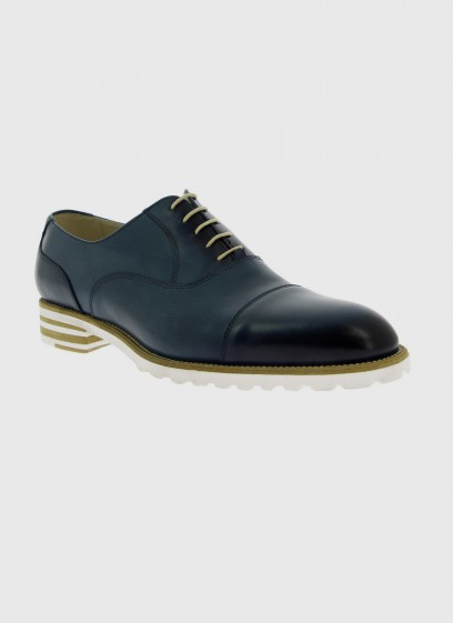 Leather brogue shoe with rubber sole by Emmanuelle Khanh